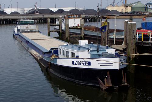Als beunschip POPEYE op de Wachtsteigers in de Botlek op 15-06-2003.